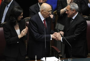 Giorgio Napolitano (C) is applauded by Chamber of Deputies president Laura Boldrini (L), while being congratulated by Senate president Pietro Grasso (R), at the Italian parliament in Rome, 22 April 2013.