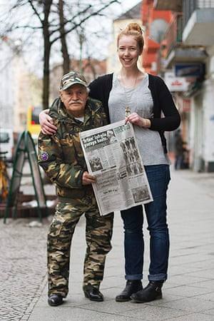 Big Picture - what ali: young woman standing next to middle eastern man holding newspaper