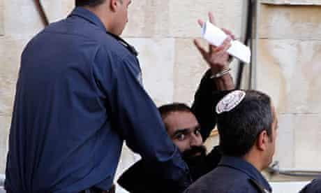Samer al-Issawi gesturing as he leaves Jerusalem's magistrates' court