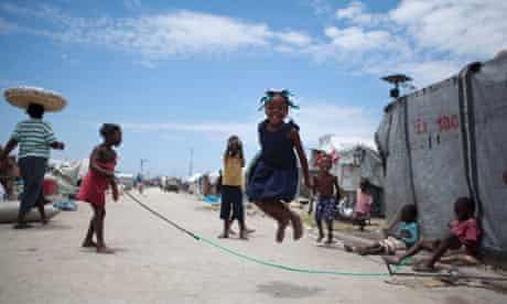 A young girl skipping inside the Jean-Marie Vincent camp for people displaced by the 2010 earthquake in Port-au-Prince, Haiti.