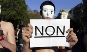 Au contraire: Bare-chested men sporting white masks belonging to an anti-gay group (Homen, Hommen) demonstrate against the bill legalizing same sex marriages in Paris.