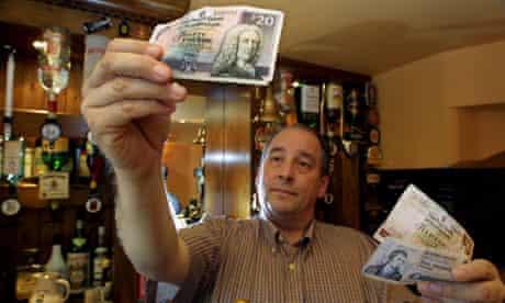 Barman holds Scottish pound