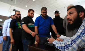 Lebanese Sunni Muslim men queue as they register their names for jihad in Syria, at a mosque in the southern port city of Sidon, Lebanon, Tuesday April 23, 2013. Lebanese Sunni Muslim clerics Ahmad Al-Assir and Sheikh Salem al-Rafie called for jihad in Syria to protect Sunnis in villages under attack by Syrian troops and pro-government Shia gunmen.