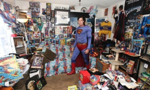 Picture Desk Live gets off to a flying start with the Man of Steel wannabe Christopher Dennis. Here he is in his living room in Los Angeles surrounded by an astonishing 15,000 collectibles, worth a whopping $100,000. He is definitely looking forward to the film coming out later this year.