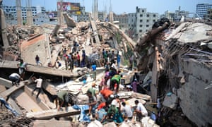 Bangladeshi civilian volunteers assist in the rescue operation after an eight-storey building collapsed in Savar, on the outskirts of Dhaka. At least 15 people were killed and many more feared dead when the building housing a market and garment factory collapsed.