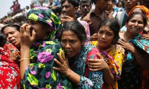 People mourn for their relatives, who are trapped inside the rubble. You can see a gallery of images from the tragedy here. Photograph: Andrew Biraj/Reuters