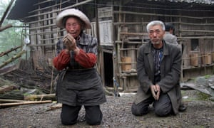 Similar scenes occur in China, where some of the population of the earthquake hit Sichuan province are still awaiting help. Here an elderly couple kneel down as rescuers arrive in their village in Baoxing County.