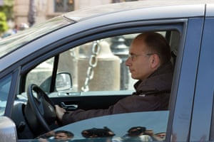 Italian leftist Enrico Letta drives his car as he arrives at the Quirinale presidential palace on April 24, 2013 in Rome to meet Italian President Giorgio Napolitano.