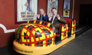 """And I think it's time for an awkward photocall picture. Uncomfortable Nick Park and friend say """"cheese"""" at the opening of the worlds first Wallace & Gromit ride, 'Thrill-O-Matic', at the Blackpool Pleasure Beach, England."""