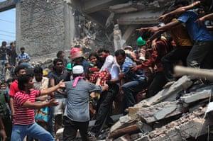 Building collapse: Bangladeshi volunteers evacuate an injured person