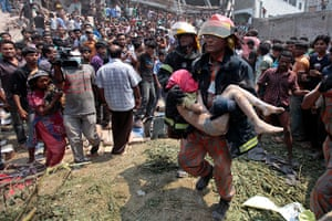 Building collapse: rescuers carry a victim
