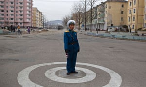 A North Korean traffic policeman stands at an intersection in Kaesong.