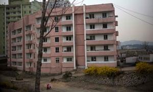 North Korean children walk in front of an apartment block in Kaesong.