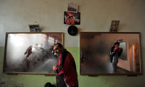 Afghan boxers at the  Sabawon Azizi Boxing Club on the national stadium premises in Kabul. Afghan youth have made headways in boxing since the fall of the Taliban, who declared the sport to be 'against human dignity' and banned it.