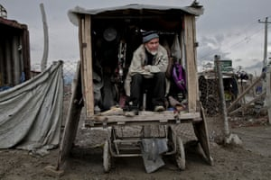 Away from the earthquake, vendor Ashoor Mohammad, 60, waits for customers on the outskirts of Kabul, Afghanistan.