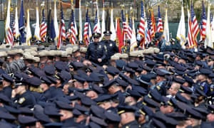 Police officers arrive at a memorial service for fallen Massachusetts Institute of Technology campus officer Sean Collier at MIT in Cambridge, Massachusetts. Authorities say Collier was killed by the Boston Marathon bombing suspects last Thursday, April 18. He had worked for the department a little more than a year.