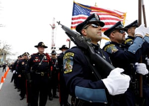 Two more images from memorial service in Massachusetts. Here members of a police honour guard lead a column of law enforcement officials into the service for fallen Massachusetts Institute of Technology police officer Sean Collier.