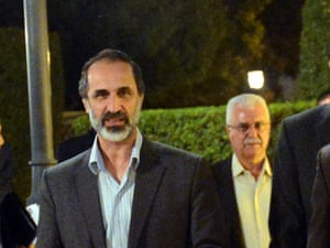 Syria's former opposition leader Moaz al-Khatib and acting leader George Sabra at a meeting in Cairo in November.