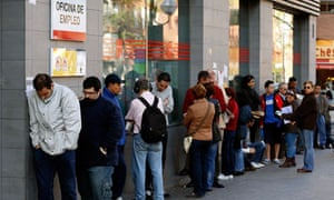 Spain unemployment – people queue outside a government-run job centre in Madrid