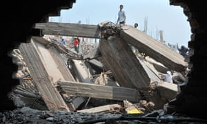 Rescuers work at the collapsed Rana Plaza building