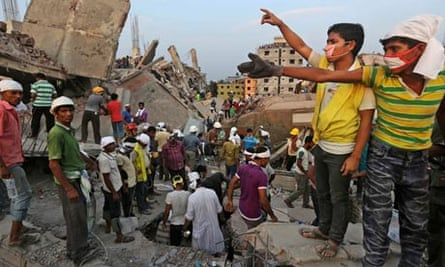 Bangladeshi rescuers at the site of the building collapse near Dhaka