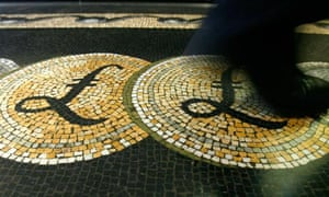 Employee walking over a mosaic depicting pound sterling symbols