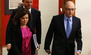 Spanish economy minister Luis de Guindos (back), deputy prime minister Soraya Saenz de Santamaria (left) and treasury minister Cristobal Montoro arrive to unveil a cut in growth forecasts. Photograph: Reuters/Sergio Perez