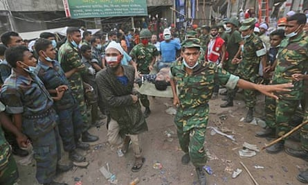 A Bangladeshi garment worker pulled alive from the rubble of Rana Plaza is rushed to hospital