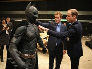 Royal Warner Bros: Prince William and Prince Harry look at a 'Batsuit'