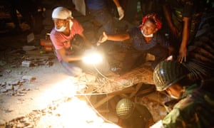 Rescue workers work to find garment workers trapped in the collapsed Rana Plaza building