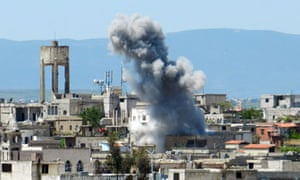 Shelling in Houla in Syria's Homs province. The opposition National Coalition has accused the regime