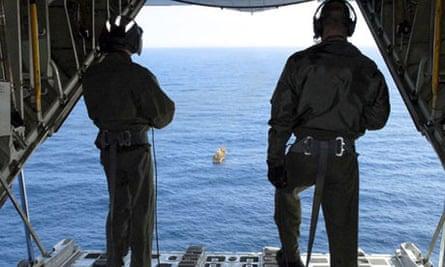 Crew on board a US Coast Guard Hercules plane.