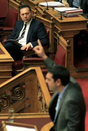 Greek Finance Minister Yannis Stournaras (L) watch main opposition Radical Left Coalition (SYRIZA) leader Alexis Tsipras (R) who speaks during a debate in the Greek Parliament, in Athens, Greece, 28 April 2013.
