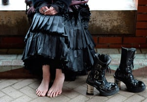 whitby goth festival: A woman sits rests her feet