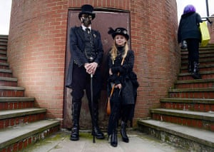 whitby goth festival: Heath Waller and his daughter Meagan, 10,  pose for photographs