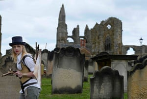 whitby goth festival: Goths roam the grounds of Whitby Abbey
