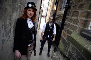 whitby goth festival: Goths pose for photographs in an alleyway