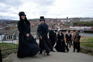 whitby goth festival: Goths climb the steps to Whitby Abbey, which overlooks the town