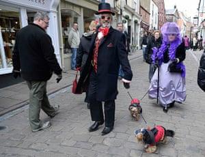 whitby goth festival: Goths walk their dogs through the town centre