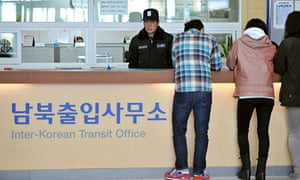 South Koreans seek information at the crossing into the Kaesong factory park just inside the North