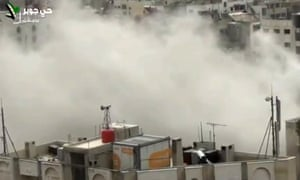An image taken from video obtained from Shaam News Network, which has been authenticated based on its contents and other Associated Press reporting, shows smoke from heavy shelling in the Jobar neighbourhood in north Damascus on 2 April. Syrian government warplanes were reported to have carried out air strikes on the capital on Wednesday morning.