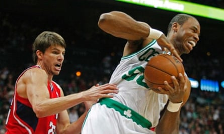 Boston Celtics center Jason Collins (R), grabs a rebound away from Atlanta Hawks guard Kyle Korver in the first half of their NBA basketball game in Atlanta, Georgia in this file photo taken January 5, 2013. Collins, a veteran center in the National Basketball Association (NBA), announced on Monday that he was gay, becoming the first active player from any of the U.S. professional sports leagues to publicly reveal his homosexuality.   REUTERS/Tami Chappell/Files    (UNITED STATES - Tags: SPORT BASKETBALL SOCIETY)