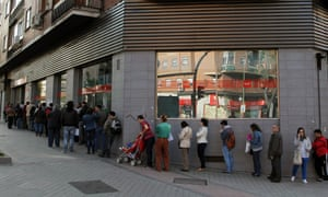 People queue outside an office to register for job placement in Madrid, Spain Thursday April 25, 2013.