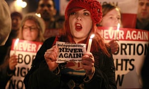Abortion rights demonstrators hold a vigil for Savita Halappanavar in Dublin