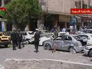 Syrian TV  shows police at the scene following a blast that rocked the central Damascus district of Marjeh causing casualties.