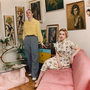 big pic - mods : mod couple sitting in room with pink sofa and artwork on walls