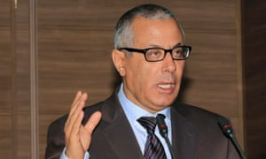 Libya's prime minister, Ali Zaidan, addresses a news conference after gunmen surrounded Libya's foreign ministry on Sunday, calling for a law banning officials who worked for deposed dictator Muammar Gaddafi from senior positions in the new administration.