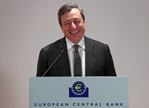 Mario Draghi, President of the European Central Bank, ECB (L), reacts during the awarding ceremony of the Generation Euro Student's Award in Frankfurt/Main, Germany, on April 17, 2013.