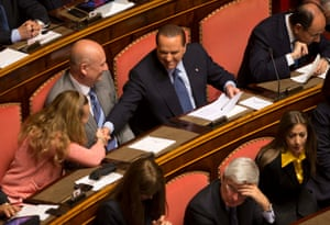Former Premier Silvio Berlusconi, tsecond from right at top, shakes hands with an unidentified lawmaker as he attends a session for a second vote of confidence to confirm the new government, in the Italian Senate in Rome, Tuesday, April 30, 2013.