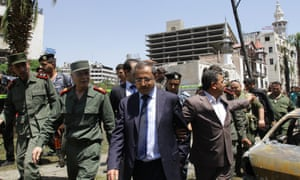 Syrian interior minister Mohammad al-Shaar inspects the site of the explosion in the al-Marjeh area close to the former interior ministry building.